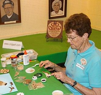 Crop art - Linda Paulsen demonstrates making seed art at the Minnesota State Fair