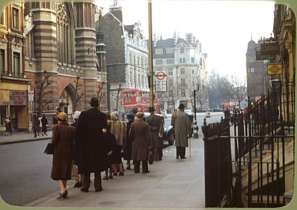 London , bus stop , circa 1949 ,Kodachrome by chalmers Butterfield.jpg