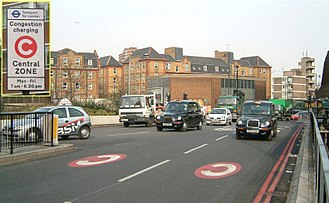 London congestion charge - Street markings and a sign (inset) that alert drivers entering the charge zone at Old Street. The sign displays the original operating hours for the scheme.