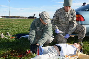 512th Airlift Wing - 512th Aerospace Medicine Squadron, simulate first response treatment of a Delaware Civil Air Patrol cadet during a training exercise November 2, 2014, at Dover Air Force Base.