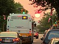 MBTA route 88 bus on Highland Avenue at sunset, July 2015.JPG
