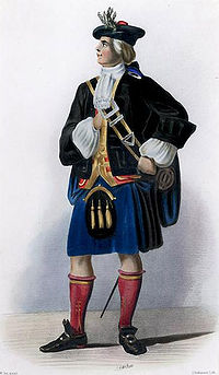 A man in elaborate eighteenth century highland dress wearing a black jacket, purple kilt-like garment and armed with a basket-hilted sword