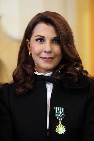 Ordre des Arts et des Lettres - Image: Magida El Roumi wearing the Officers badge in 2013