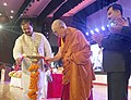 "Mahesh Sharma and His Holiness the Dalai Lama lighting the lamp to inaugurate the ""International Buddhist Conference"", organised by the Ministry of Culture and Nava Nalanda Mahaviahra, Deemed University, at Rajgir, Bihar.jpg"