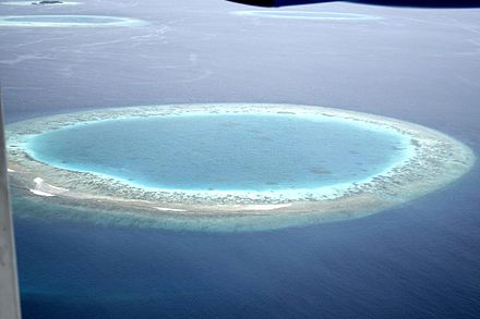 A coral atoll in the Maldives Maldives small island.jpg