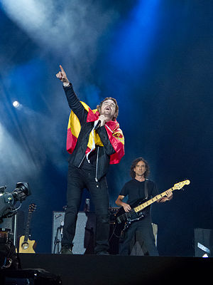 Maná - Lead singer Fher Olvera and Juan Calleros in the background performing at Rock in Rio Madrid 2012.
