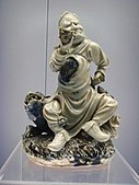 Man blowing conch (Wanli Reign Period).JPG