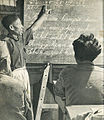 Man teaching adults to read in Kalimantan, Indonesia Tanah Airku, p22.jpg