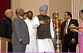 """Manmohan Singh lighting the lamp to inaugurate the International Conference of """"Jurists on Terrorism, Rule of Law & Human Rights"""", jointly organised by Council of Jurists.jpg"""
