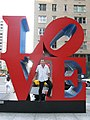 Marc-Olivier Strauss-Kahn standing in the LOVE sculpture in New York City.jpg