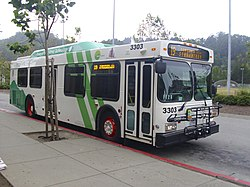 A Marin Transit New Flyer 35-foot low-floor hybrid bus operating as a Route 19 to Tiburon at Marin City. This bus operates using hybrid-electric technology, allowing it to save fuel costs by using electric power when used on city streets.