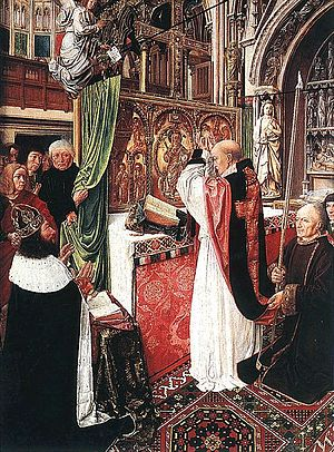 Basilica of St Denis - 15th-century painting by the Master of Saint Giles, showing St Denis saying mass before Charlemagne or Charles Martel with what is thought to be a largely accurate view of the abbey with a crux gemmata given by Charles the Bald and gold altar reredos, both destroyed in the Revolution.
