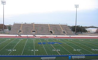 Maverick Stadium - The playing field, installed in 2009, and the east stands, where the visitors sit.