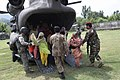 Members of the Pakistan Military Help Civilians Unload (4863482236).jpg