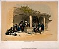 Men smoking and drinking outside a coffee shop in Cairo. Col Wellcome V0019182.jpg