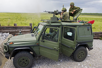 Live fire exercise - A Canadian Army Mercedes-Benz G-Class wagon in a live-fire exercise with Canadian soldier firing the mounted C6 GPMG.
