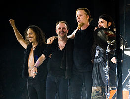 Members of Metallica performing onstage