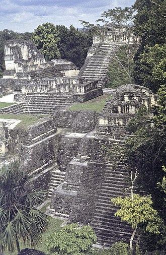 North Acropolis, Tikal - View across the North Acropolis. At back: Temples 23, 20 and 22. Temple 26 is in the centre; Temple 32 dominates the foreground, with Temple 33 to its left.