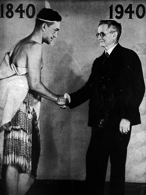 New Zealand Centennial Exhibition - Then Prime Minister, Michael Joseph Savage shaking hands with a Maori man at the exhibition