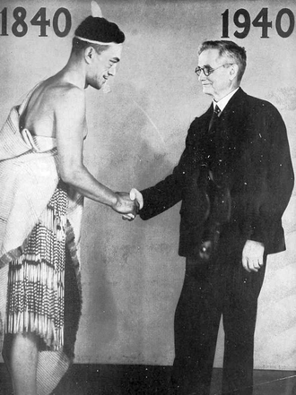 New Zealand Centennial Exhibition - Then Prime Minister, Michael Joseph Savage shaking hands with a man at the exhibition