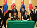 Minoru Kiuchi as State Minister for the Environment signing the Japanese-Mongolian Climate Agreement, December 2018.jpg