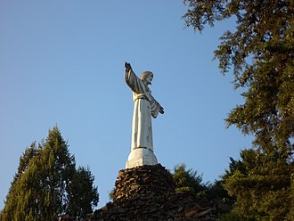 Miranda do Corvo - A view of the Christ the King statue on the hilltop of Alto do Calvário