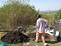 Mixing the compost heap manually (6881962787).jpg
