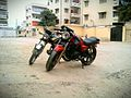 Modified Suzuki GS 150 in red and stock Suzuki 110 in black.jpg