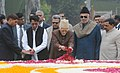 Mohd. Hamid Ansari and the Union Minister for Civil Aviation, Shri Ajit Singh paying floral tributes to the former Prime Minister, Late Ch. Charan Singh on his 111th birth anniversary, at Kisan Ghat, in Delhi.jpg
