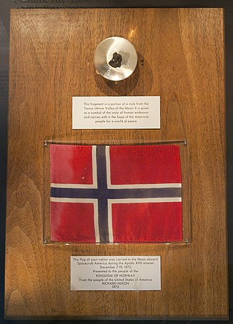 Natural History Museum at the University of Oslo - Detail of the Apollo 17 exhibit from the Geological museum, showing a moon rock and a space flown Norwegian flag.