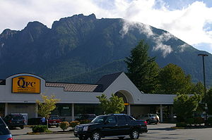 North Bend, Washington - Mt. Si and Little Si behind food store.