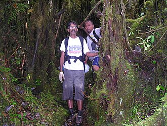 Muthukrishnan and Orang Asli Guide at Mount Korbu.JPG