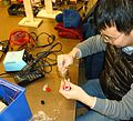 NYU student soldering electronic components.jpg