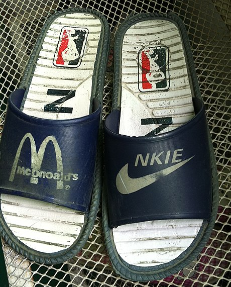 "Intellectual property laws such as trademark laws forbid the sale of infringing goods like these ""McDnoald's"" [sic] and ""NKIE"" [sic] sandals."