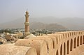 Nizwa Fort and Minaret of Friday Mosque.JPG