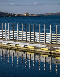 North Harbor Lysekil pier 5 reflection and Stora Skeppsholmen.jpg