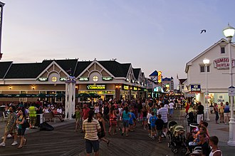 Ocean City, Maryland - A view of the Ocean City boardwalk at twilight looking north.