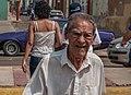 Old man walking down in Maracaibo center.jpg