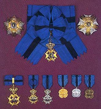 Order of Leopold II - Top left and center: Grand Cross' plaque and sash, top right: Grand Officer's plaque, bottom, from left to right: Commander's cross, Officer's cross, Knight's cross, Gold Medal, Silver Medal, Bronze Medal (courtesy Société de l'Ordre de Léopold)
