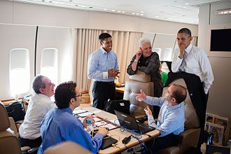 Rajiv Shah - President Obama talks with advisors aboard Air Force One during a flight from Johannesburg to Cape Town, South Africa, June 30, 2013. Included are: Mike Froman, U.S. Trade Representative; Grant Harris, Senior Director for African Affairs; USAID Administrator Raj Shah; Gayle Smith, Senior Director for Development and Democracy; and Ben Rhodes, Deputy National Security Advisor Ben Rhodes. (Official White House Photo by Pete Souza)