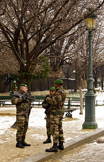 Legionnaires in Paris on Vigipirate, France's counter-terrorism security alert system, in November 2010 Patrol paratroopers foreign legion paris notre dame.jpg