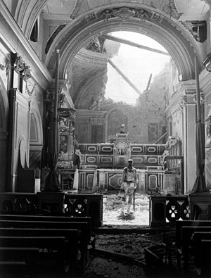 Acerno - Pvt. Paul Oglesby, of the U.S. 30th Infantry, standing in reverence before an altar in a damaged Catholic Church in Acerno