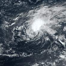 Satellite image of a cyclone where the thickest clouds are displaced from the central vortex