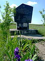 Pavlivka Ivanychivskyi Volynska-Memorial sign military units that liberated village-situated before villiage.jpg