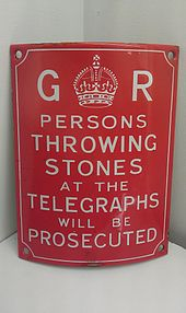 """Enamel sign bearing the cypher of King George and reading 'Persons throwing stones at the telegraphs will be prosecuted'"""