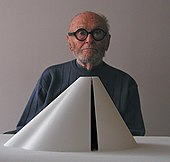 The first winner Philip Johnson behind an architectural model