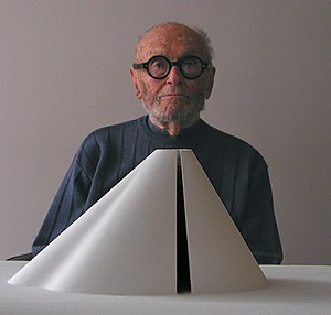 Philip Johnson - Philip Johnson at age 95 in his office in the Seagram Building, Manhattan with his model of a 30' by 60' sculpture created for a Qatari collector. (2002)