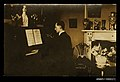 Photographic postcard of a young man playing the piano (10255386975).jpg