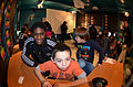 Players show highlight plays to kids 130102-A-HB521-095.jpg