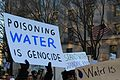 Poisoning water is genocide - Stand with Standing Rock.jpg